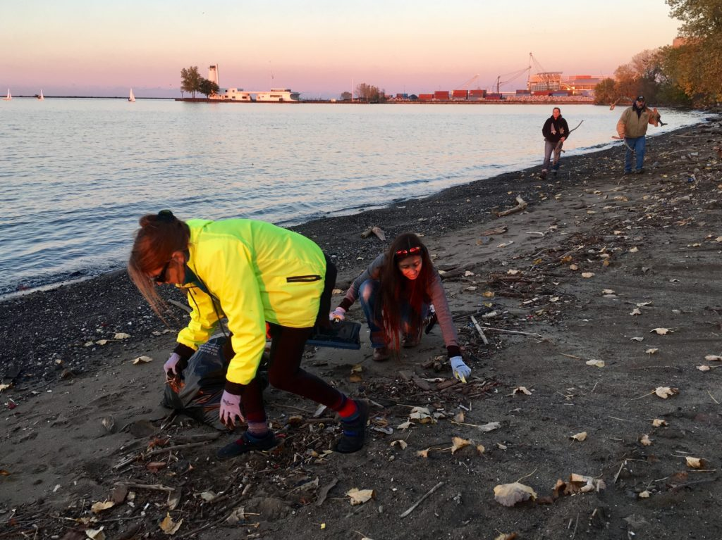 """Sarah J. Buck and Bessie """"Songbird"""" Young pick up trash on the beach at Wendy Park on Wednesday, Nov. 8."""