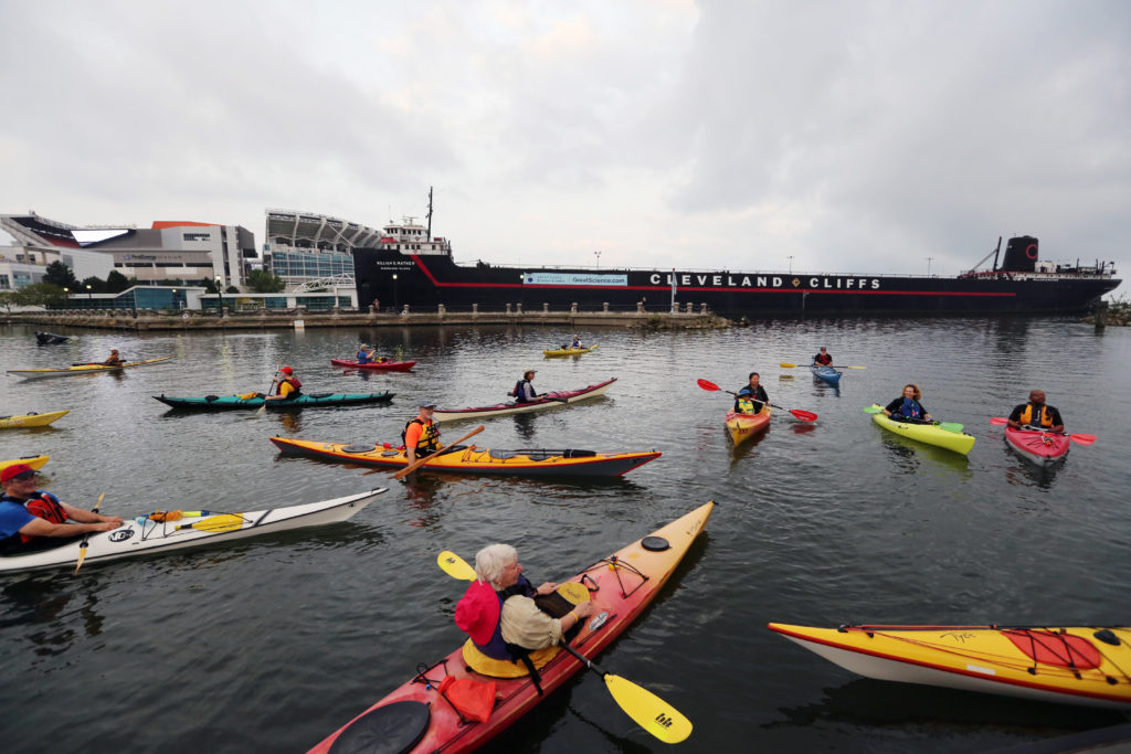 Kayakers fan out in the North Coast Harbor as they await the start of the Super Sprint Division of the Cleveland Triathlon in 2017.  (Gus Chan, The Plain Dealer)