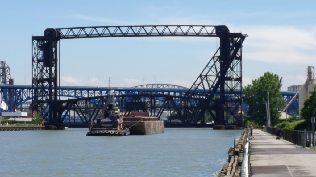 The Norfolk Southern bridge at the mouth of the Cuyahoga River is usually down, to allow 100 trains a day to cross. That means the boats wait to get through. (Tim Evanson, Creative Commons)