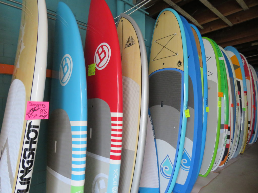 Stand-up paddleboards on sale at Nalu. (Laura Johnston, RocktheLake)