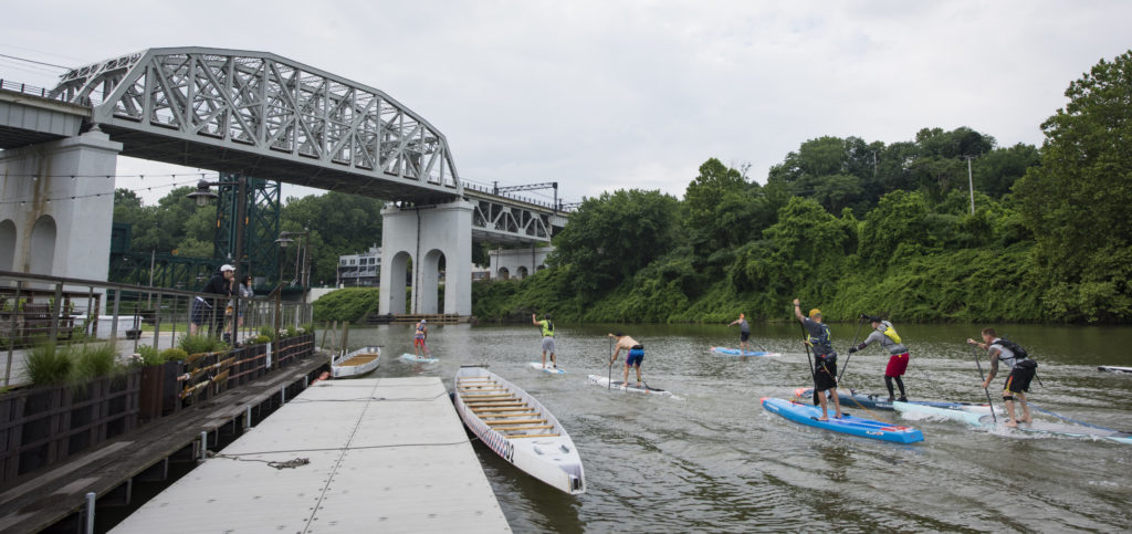 Stand up paddle boarders going under the Columbus bridge on the Cuyahoga River at Rivergate Park in Cleveland on June 23, 2018 outside Merwin's Wharf.  (Kyle Lanzer/Special to The Plain Dealer)