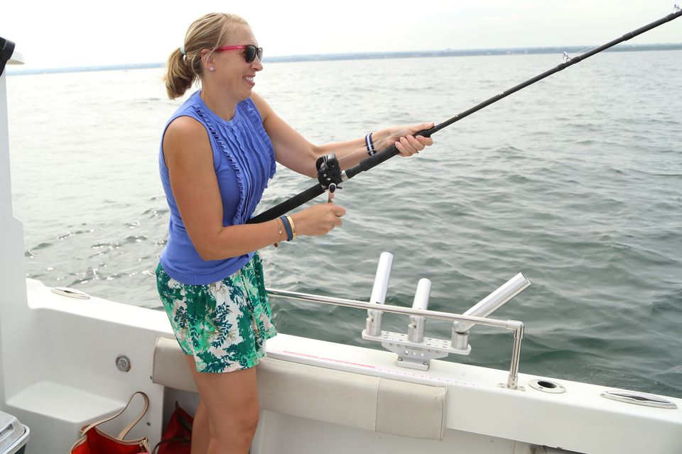 Laura Johnston reels in a walleye, one of seven we caught on two lines in about 45 minutes. (Dave Petkiewicz, cleveland.com)